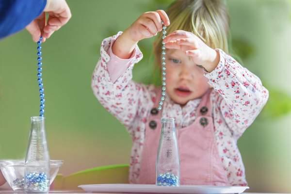 Kind - Perlen - Flasche