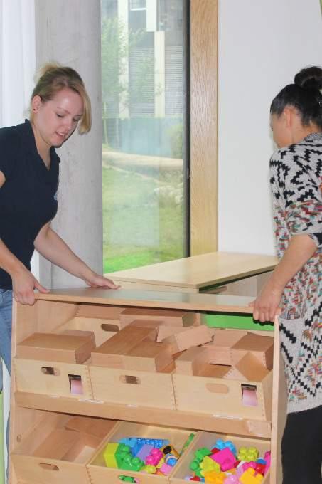 Kinderkrippe-Schwabing-Umzug-Mutter - Wichtel Akademie München
